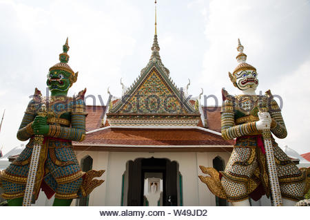 Front view of the entrance with two statues in both sides of the Emerald temple at Bangkok - Stock Photo
