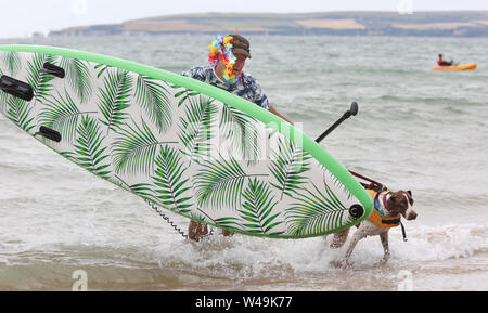 Poole, UK.  21st July 2019.   Water loving pooches and their owners compete in the UK Dog Surfing Championships off Branksome Dene Chine beach in Poole, Dorset, UK. Credit: Richard Crease/Alamy Live News - Stock Photo