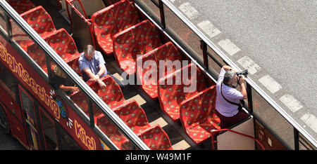 Berlin, Germany. 21st July, 2019. A man photographs the East Side Gallery from a sightseeing bus. Credit: Paul Zinken/dpa/Alamy Live News - Stock Photo