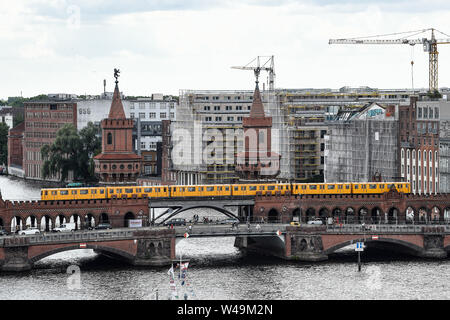 Berlin, Germany. 21st July, 2019. An underground train of the line U1 crosses the Oberbaumbrücke. Credit: Paul Zinken/dpa/Alamy Live News - Stock Photo