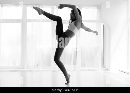 Modern Dance Artist Dancing In Ballet Studio - Stock Photo