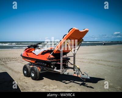 Egmond aan Zee, Netherlands - July 21, 2019: a jetski of the dutch coastguard on the beach - Stock Photo