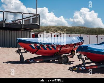 Egmond aan Zee, Netherlands - July 21, 2019: lifesaving ships of the dutch coastguard on the beach - Stock Photo