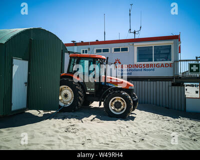 Egmond aan Zee, Netherlands - July 21, 2019: a tractor of the dutch coastguard on the beach in front of the coastguard station - Stock Photo