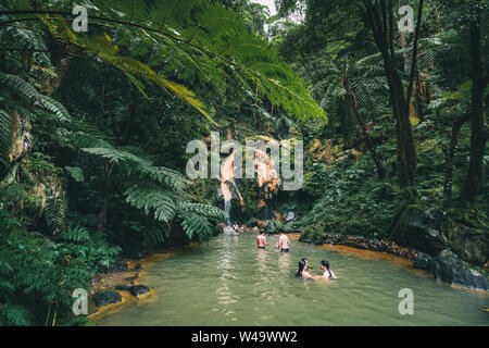 SAO MIGUEL, AZORES, PORTUGAL - JULY 29, 20189 People enjoy bath in natural thermal pools, spa of Caldeira Velha near Ribeira Grande town, Sao Miguel - Stock Photo