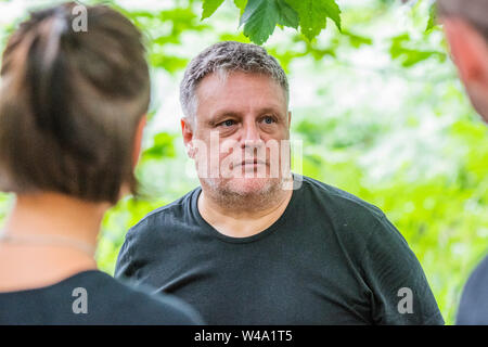 Henham Park, Suffolk, UK. 21 July 2019. Rankin shoots festival goers in the Faraway forest. The 2019 Latitude Festival. Credit: Guy Bell/Alamy Live News Credit: Guy Bell/Alamy Live News - Stock Photo