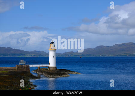 Landscape view of Rubha nan Gall Lighthouse near Tobermory on the Isle of Mull in Scotland on a summer day with blue skies, clouds and a deep blue sea - Stock Photo