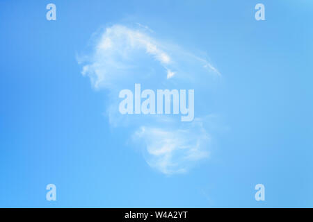 Single white translucent cirrus cloud high in the blue summer sky. Different cloud types and atmospheric phenomena. Skyscape on a sunny day. - Stock Photo