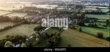Aerial view of Lower Slaughter Cotswold village by River Windrush Gloucestershire