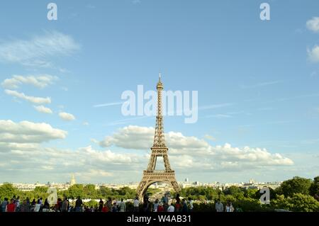 Paris/France - August 18, 2014: Beautiful panoramic view to the Eiffel Tower from Trocadero gardens viewpoint with tourists admiring the city. - Stock Photo