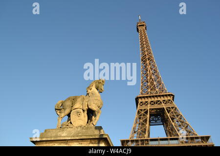 Sculpture of a horse on the Jena bridge in Paris and the Eiffel Tower in the background in a bright sunny day. - Stock Photo