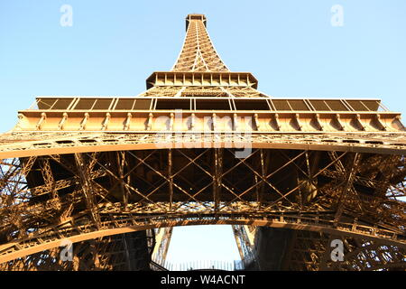 View to the Paris Eiffel Tower complex structure from the ground. - Stock Photo