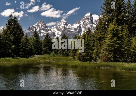 Mount Moran and the Grand Teton mountains reflected on the Snake River at Schwabacher Landing Beaver Pond in the Grand Teton National Park in Moose, Wyoming. - Stock Photo