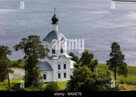 Church Of The Exaltation Of The Holy Cross of Nilov Monastery is located on the southwest side of Stolobny island, Tver region, Russia - Stock Photo