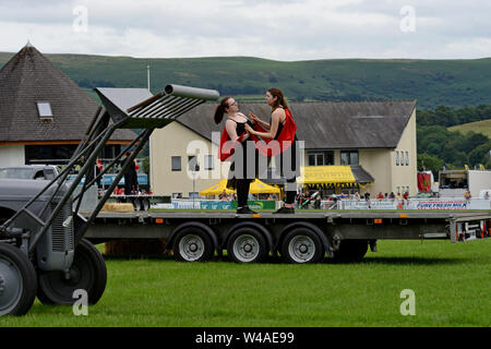 Builth Wells, Wales, UK. 21st July 2019. Performers rehearse for the opening ceremony of the 100th Royal Welsh Show, which starts tomorrow. The event is the largest agricultural show in the UK and attracts around 200,000 people over 4 days. G.P. Essex/Alamy Live News - Stock Photo