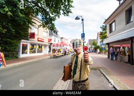 Hude, Germany, July, 21 2019: the day after the italian night in the municipality of hude lower saxony. A disguised comedian in a police costume with - Stock Photo