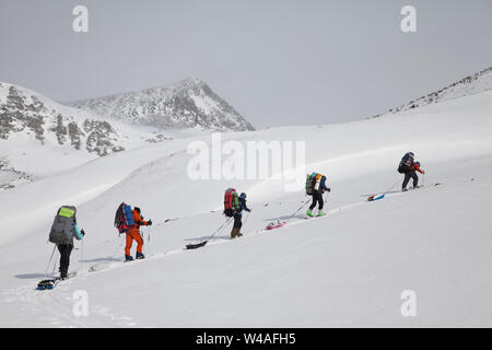 Backpacking ski tour climbers in Altay high mountains. Siberia. Russia. - Stock Photo