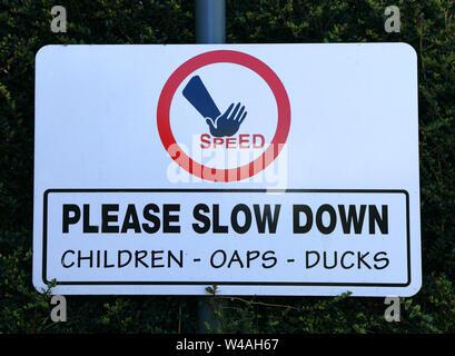 Slow Down, sign, traffic, roadside, Children, OAPs, Ducks - Stock Photo