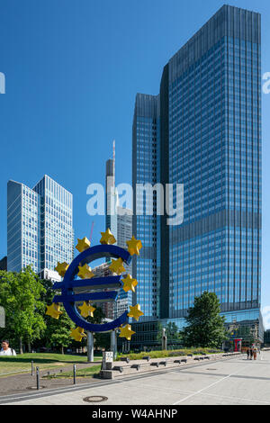 Frankfurt am Main, July 2019. A view of the Euro symbol in front of the Eurotower skyscraper - Stock Photo