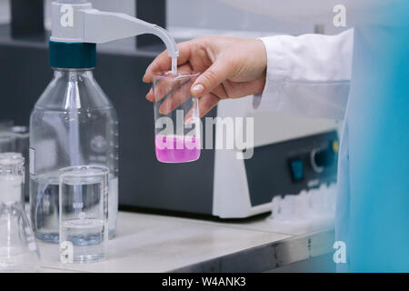 Scientist holding a test tubes, Laboratory research. Scientist with test tube making research in clinical laboratory. - Stock Photo