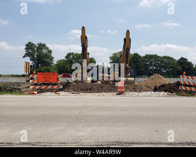 Two excavators at a construction entrance to the widening project of Interstate 94 near the new Foxconn site in Racine, Wisconsin on July 20, 2019. - Stock Photo