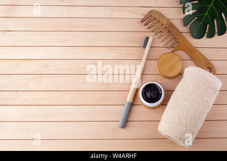 Zero waste flat lay. Bamboo toothbrush, wooden brush on wooden background. Eco products plastic free - Stock Photo
