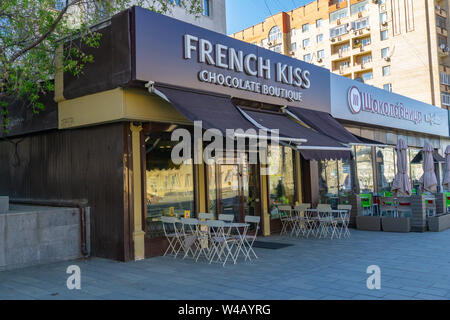 MOSCOW, RUSSIA - APRIL 20, 2019: Cozy street with tables of french kiss cafe. Architecture and landmarks - Stock Photo