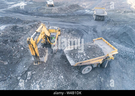 Excavator Loading Coal Truck from Aerial View - Stock Photo