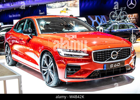 Brussels, Belgium, Jan 2019: metallic red Volvo S60 at Brussels Motor Show, executive sedan manufactured by Swedish automaker Volvo Cars - Stock Photo