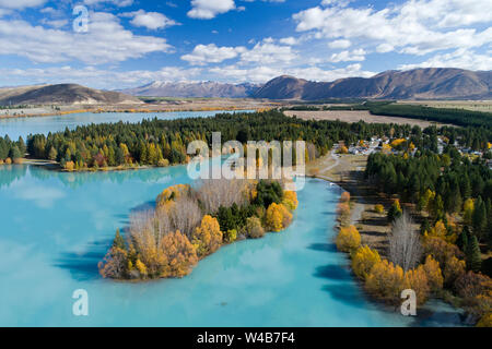 Lake Ruataniwha and Lake Ruataniwha Holiday Park (at right) in autumn, Mackenzie Country, South Island, New Zealand - aerial - Stock Photo