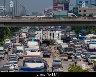 Bangkok, Thailand - May 28, 2018: Traffic jam on Kanchana Phisek Road, the ring road around Bangkok, in 35 degrees Celsius. The heat is so strong that - Stock Photo