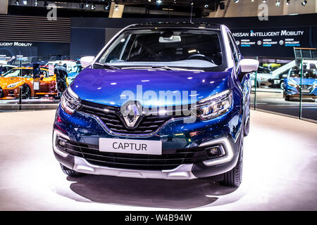 Brussels, Belgium, Jan 2019 blue New Renault Captur urban crossover, Brussels Motor Show, produced by French Renault - Stock Photo