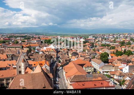 Broad panorama from the Lutheran Cathedral of Saint Mary in Sibiu, Transylvania, Romania. Casa Altemberger, the Carpathian mountains - Stock Photo