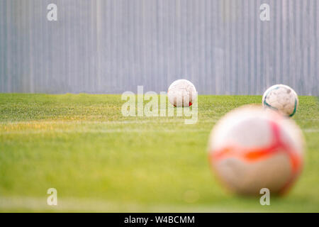 football soccer ball on the field of grass - Stock Photo
