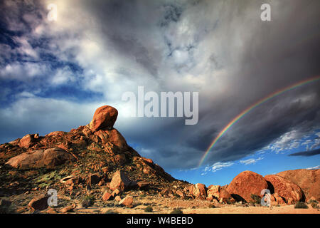 Rainbow after the storm - High desert South Africa - Stock Photo