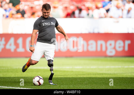 Leverkusen, Germany. 21st July, 2019. Soccer: Benefit soccer game 'Champions for Charity' in the BayArena. Former athlete Heinrich Popow plays the ball. Credit: Marius Becker/dpa/Alamy Live News - Stock Photo