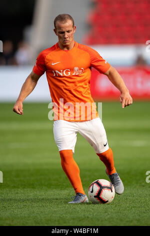 Leverkusen, Germany. 21st July, 2019. Soccer: Benefit soccer game 'Champions for Charity' in the BayArena. Former gymnast Fabian Hambüchen plays the ball. Credit: Marius Becker/dpa/Alamy Live News - Stock Photo
