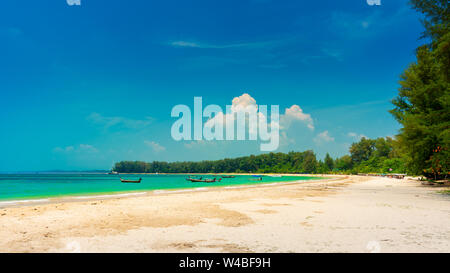 Nature landscape tropical beach Phuket with traditional wooden boat and beautiful sand beach