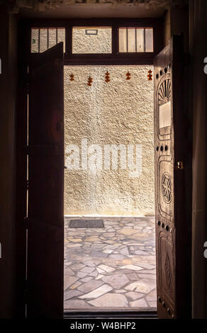 Open the door to a narrow Arab street. - Stock Photo