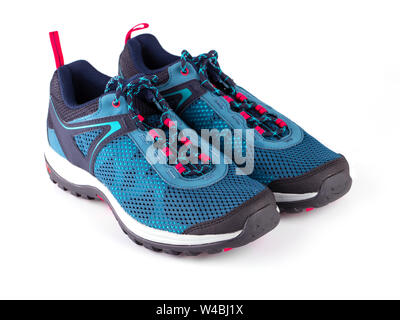 Pair of blue women's sneakers isolated on white bacxkground - Stock Photo