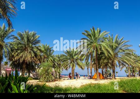 Dubai, UAE - November 30, 2018: Rest on the city beach. Al Mamzar Beach Park. - Stock Photo