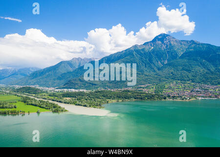Aerial view of River Adda flowing into Lake Como and Monte Legnone in background, Trivio di Fuentes, Valtellina, Lombardy, Italy - Stock Photo