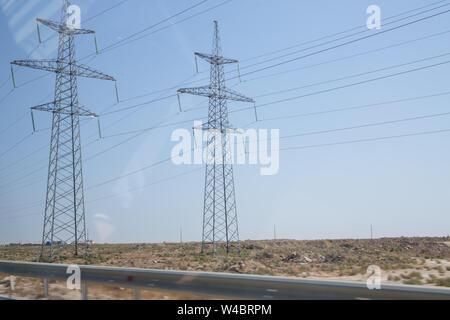Electricity transmission power lines High voltage tower . Power line high voltage post with blue sky background . Electricity pylon on nature backgrou - Stock Photo