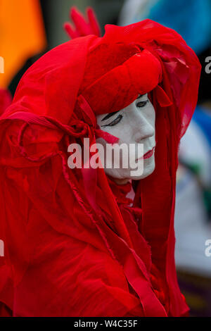 Editorial: Truro, Cornwall, UK. 20/07/2019. Extinction Rebellions art troupe The Red Rebellion parade through the streets of Truro in Cornwall. - Stock Photo