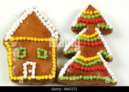 Decorated gingerbread cookies - house and Christmas tree - Stock Photo