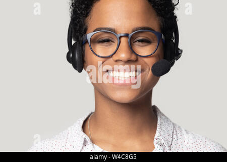 Close up portrait of happy biracial female call center agent - Stock Photo