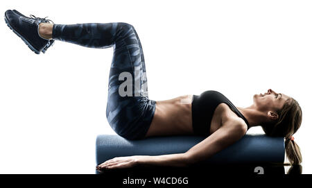 one caucasian woman exercising pilates fitness foam roller exercises isolated  silhouette on white background - Stock Photo