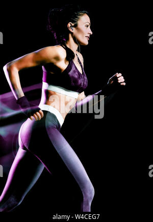 one beautiful caucasian mixed race woman unner jogger jogging running  in studio isolated on black background - Stock Photo