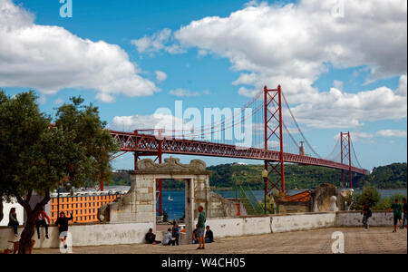 Ponte 25 de Abril, suspension bridge over River Tagus, like Golden Gate Bridge, 1966, Europe, Lisbon, Portugal, spring, horizontal - Stock Photo