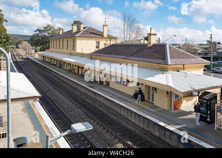 Heritage listed Mittagong Railway Station is a type 3, brick, second class station building built in 1870 and later extended in 1873 and then 1912